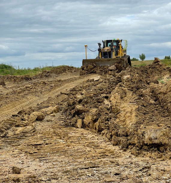 An excavator moving soil.