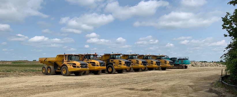 A row of trucks on site.
